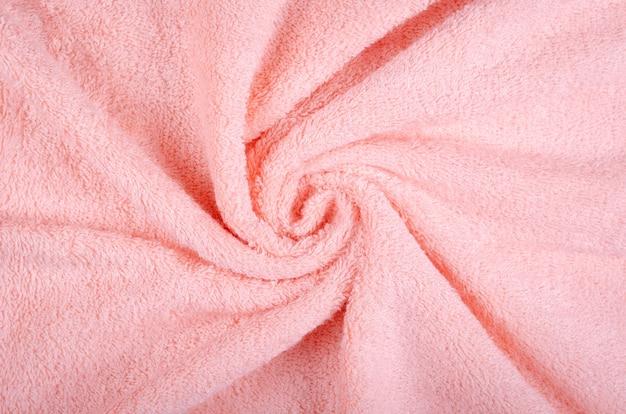 De roze textuur van de handdoekstof, hoogste meningsfoto.