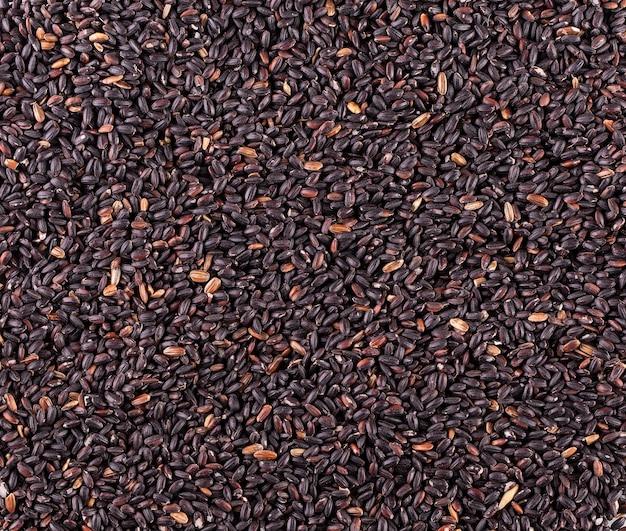 De ruwe zwarte rijst als achtergrond