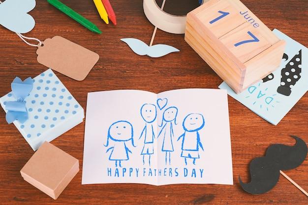 De samenstelling van de vadersdag met de tekening van het kind