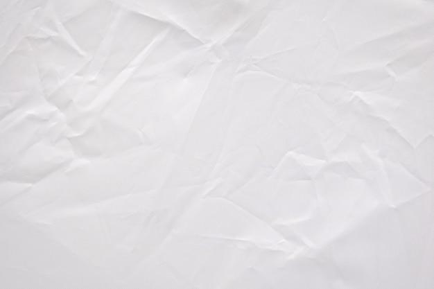 De samenvatting gevouwen achtergrond van de stoffentextuur. verfrommeld wit textielproductpatroon.