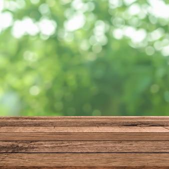 De samenvatting vertroebelde groene bladerenachtergrond met tafelblad voor toont en adverteert product