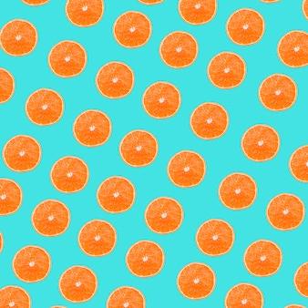 De sinaasappelen snijdt patroon op turkooise achtergrond