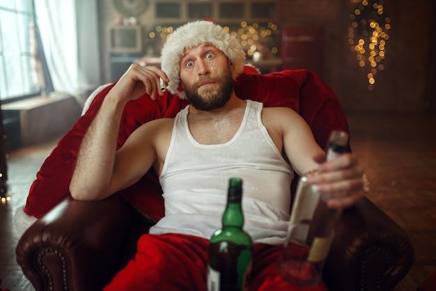 De slechte kerstman viert kerstmis met drugs en alcohol