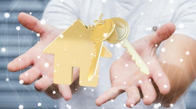 De sleutel van de zakenmanholding met huissleutelring in zijn hand het 3d teruggeven