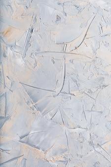 De stenen textuur van de muur is grijs met vlekjes. volledig scherm als,