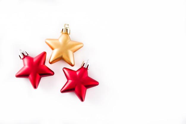 De sterdecoratie van kerstmis die op wit wordt geïsoleerd