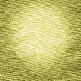 De stoffenclose-up van de mosterdkleur