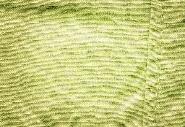 De stoffentextuur van de mosterd voor achtergrond.