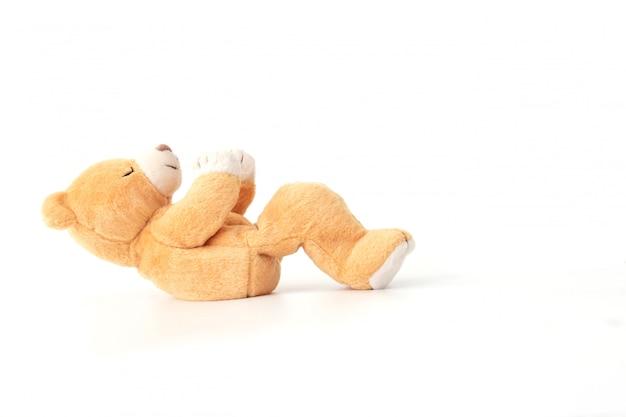 De teddybeer oefent in de gymnastiek