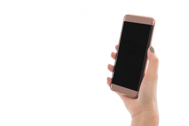 De telefoon van de handholding op witte achtergrond in studio wordt geïsoleerd die. sluit omhoog handvrouw gebruikend telefoon op geïsoleerd. ruimte voor reclame van mobiele app, mockup kopiëren