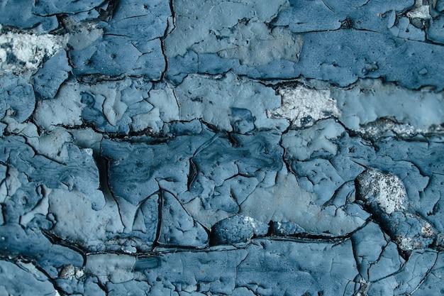 De textuur van afbladderende verf en gebarsten muur