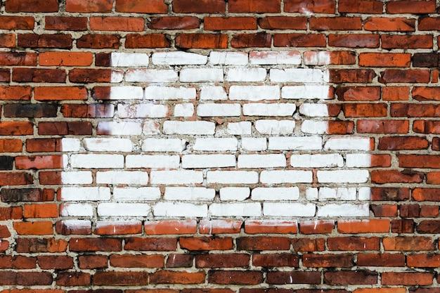 De textuur van de bakstenen muur. met wit geschilderde ruimte voor tekst. ruimte kopiëren
