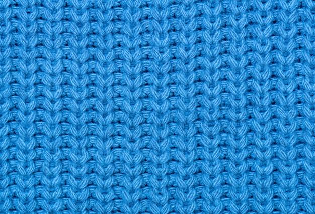 De textuur van de gebreide stof in blauw.