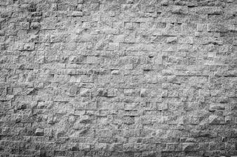 De textuur van de grijze en zwarte kleurensteenbaksteen en oppervlakte voor achtergrond