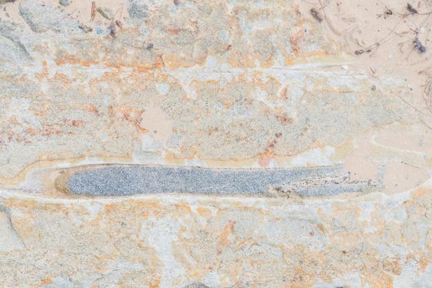 De textuur van de steen met verschillende impregnaties.