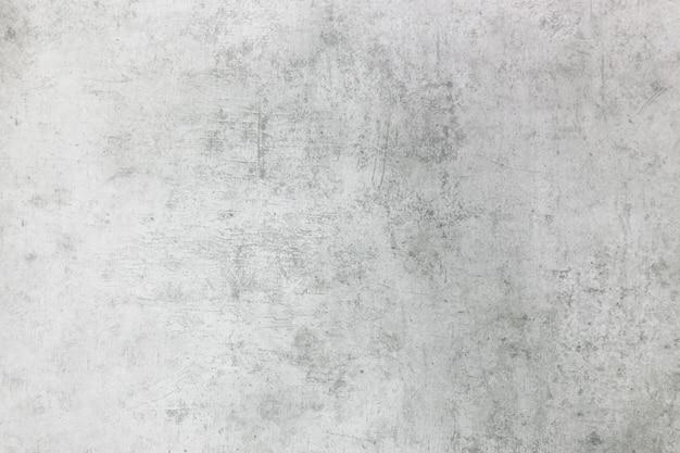 De textuur van de stenen muur is grijswit met verschillende krassen achtergrondweergavemateriaal