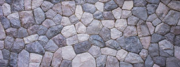 De textuur van de stenen muur voor de achtergrond
