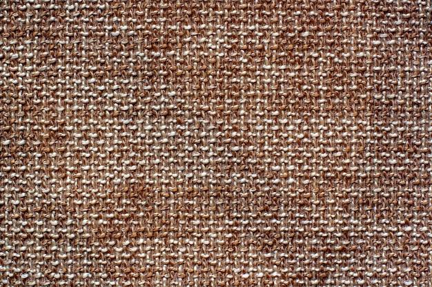 De textuur van de stof. bruine wollen interlaced stof. ruimte kopiëren