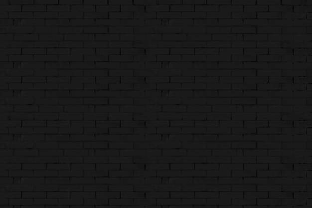 De textuur van de zwarte bakstenen muur.