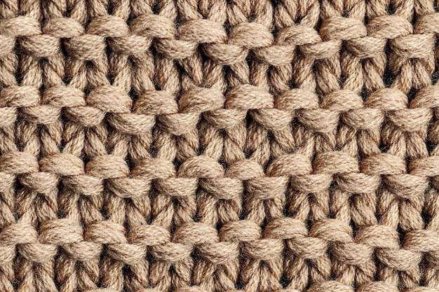 De textuur van een bruin gebreid garen. gebreide en winterkleding