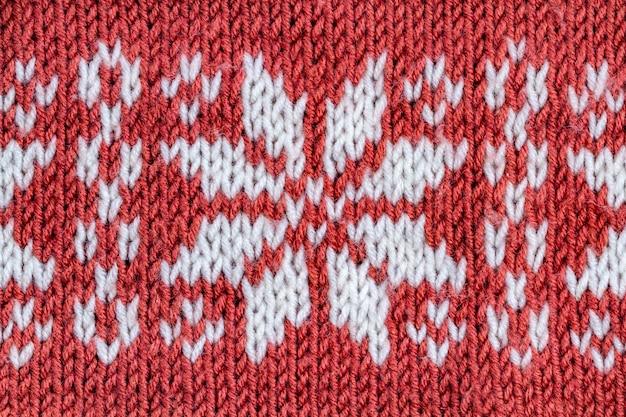 De textuur van een lelijke kersttrui. breiwerk