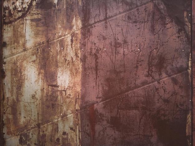 De textuur van een oude roestige metalen plaat