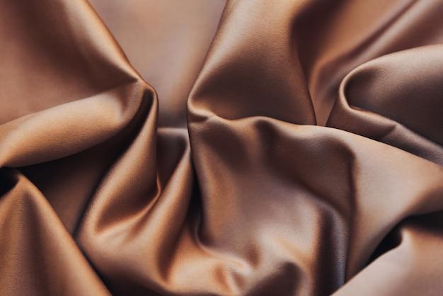 De textuur van een verfrommelde satijnen stof