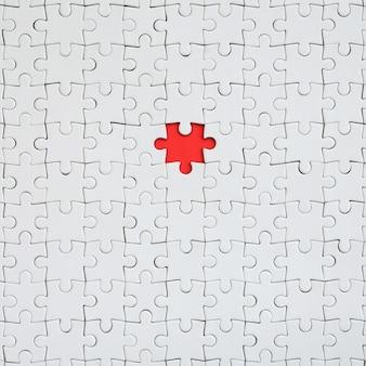 De textuur van een witte puzzel in een geassembleerde staat
