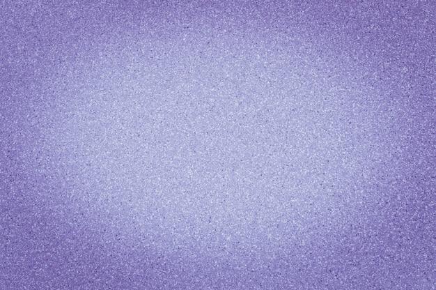 De textuur van graniet purpere kleur met kleine punten, met vignetting, gebruikt achtergrond.