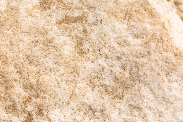 De textuur van granietbeige, achtergrond, close-up. ruimte voor tekst.