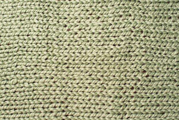 De textuur van groene wol breit algemene achtergrond