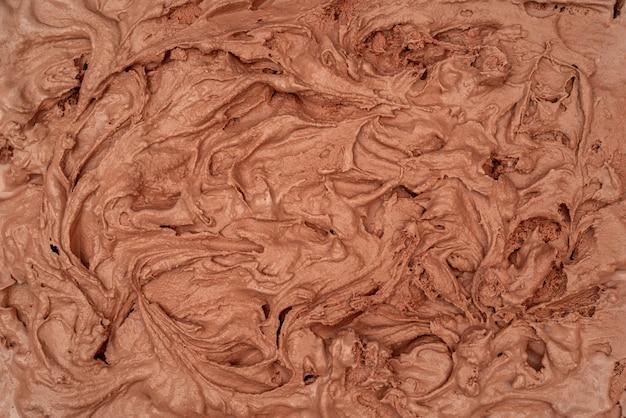 De textuur van het chocoladeroomijs. bovenaanzicht. heerlijke koele verwennerij.