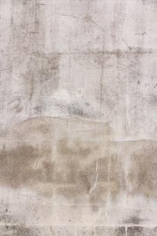 De textuur van het oude gips. ruimte voor tekst. verticale foto