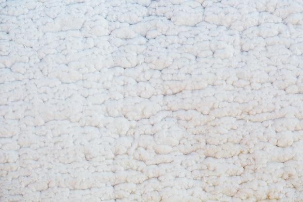 De textuur van licht calciumcarbonaat op volledig scherm als substraat