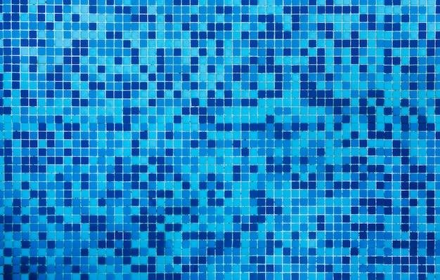 De textuurachtergrond van badkamers blauwe tegels