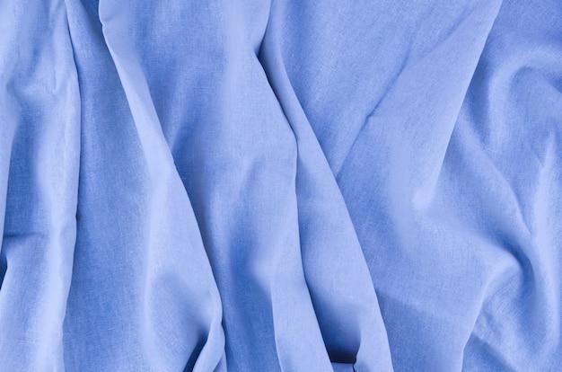 De textuurachtergrond van de close-up blauwe stof