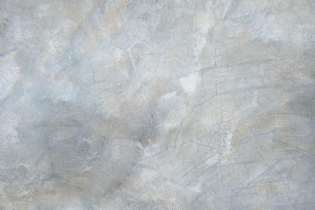 De textuurachtergrond van de grunge concrete muur.