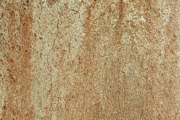De textuurachtergrond van de grunge rustieke bruine en grijze concrete muur