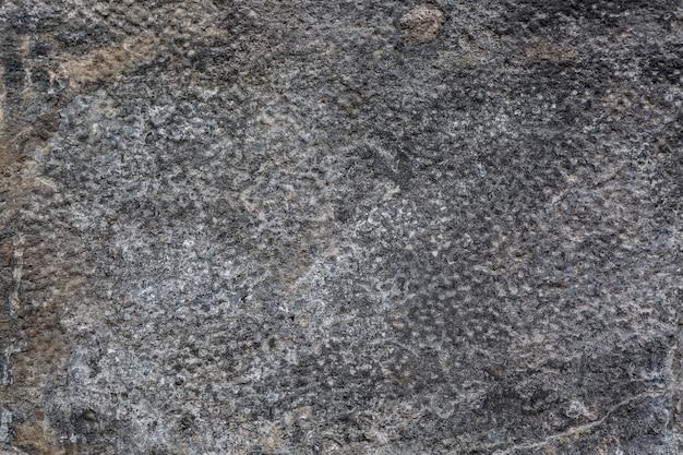 De textuurachtergrond van de grunge zwart-witte muur