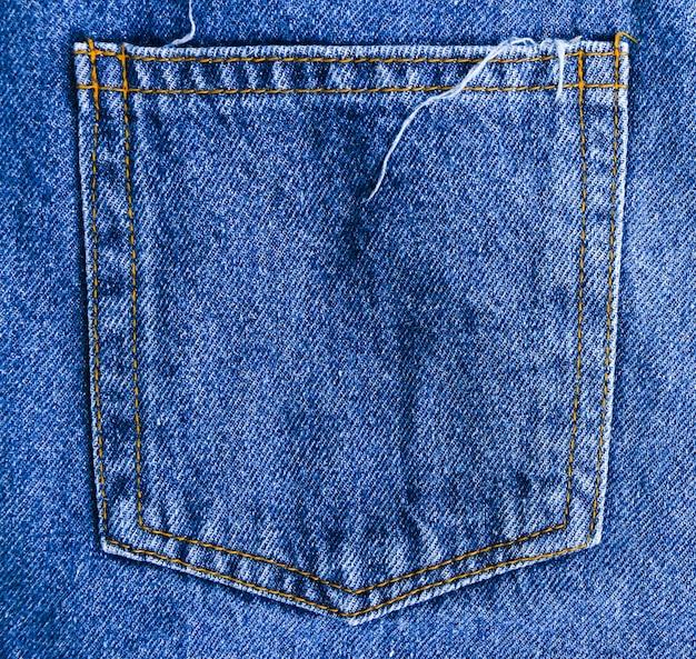 De textuurachtergrond van de jeans achterzak met lege ruimte