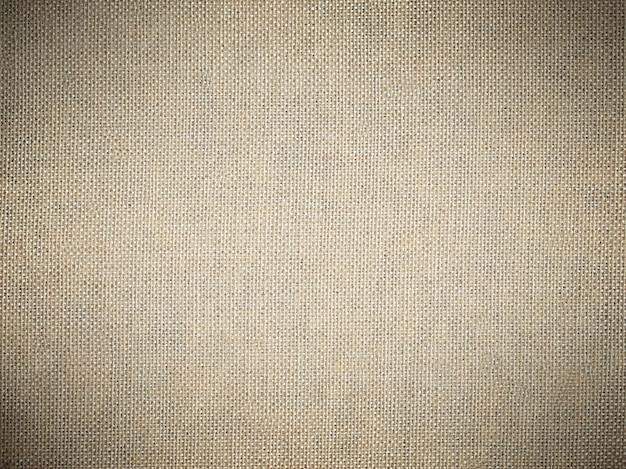 De textuurachtergrond van de jute met een donker vignet.