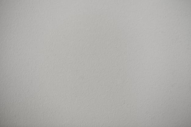 De textuurachtergrond van de muur op grijs