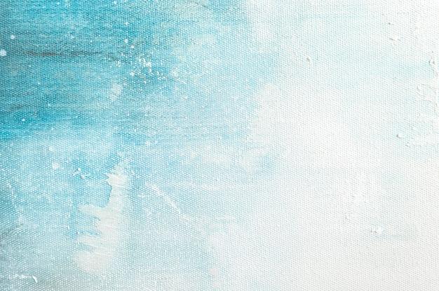 De textuurachtergrond van het canvas met het abstracte blauwe kleurrijke kunst schilderen.