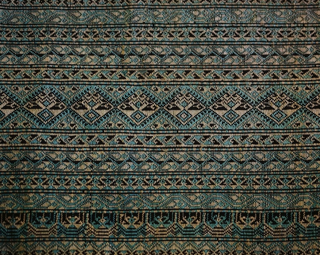 De uitstekende achtergrond van de katoenen stoffentextuur, thaise stijl