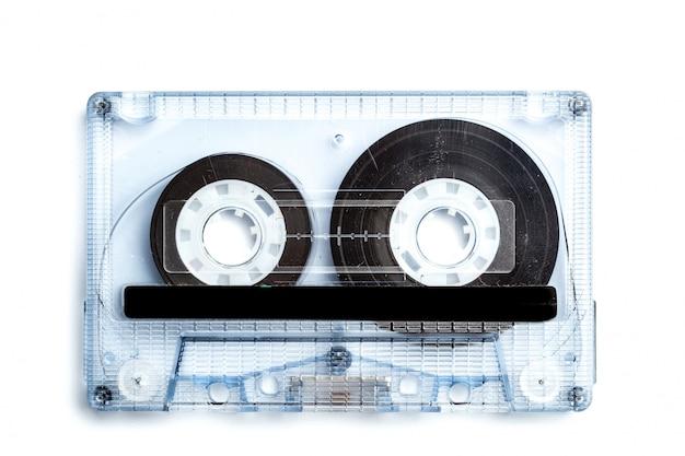 De uitstekende cassetteband isoleerde witte oppervlakte