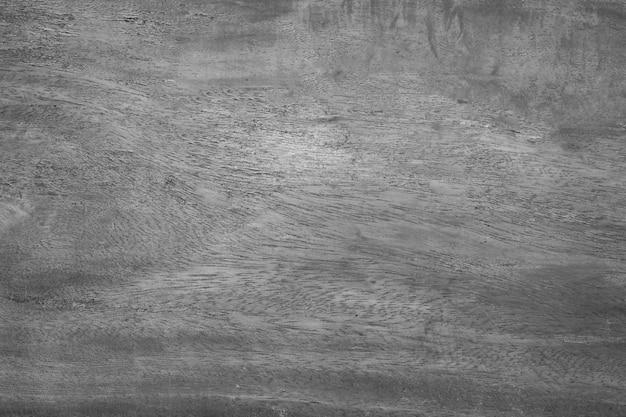 De uitstekende zwart-witte oude houten achtergrond van de muurtextuur