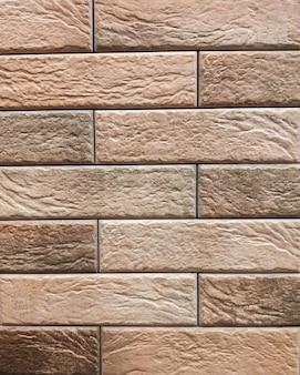 De van de muur is een rode bakstenen ondergrond. abstracte muur.