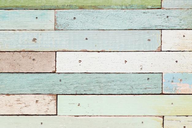 De veelkleurige oude houten plaat geweven achtergrond van de kleuren grunge voor decoratie