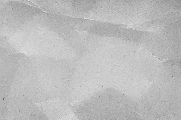De verfrommelde achtergrond van de kartontextuur. blanco vel papier.