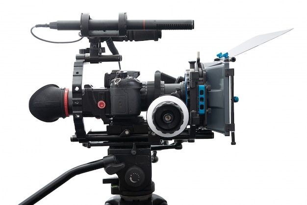 De videocamerabrig van dslr op wit wordt geïsoleerd dat